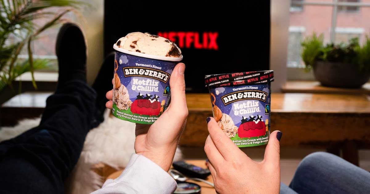 Two people sitting down to watch Netflix, holding up the new ice cream flavors.