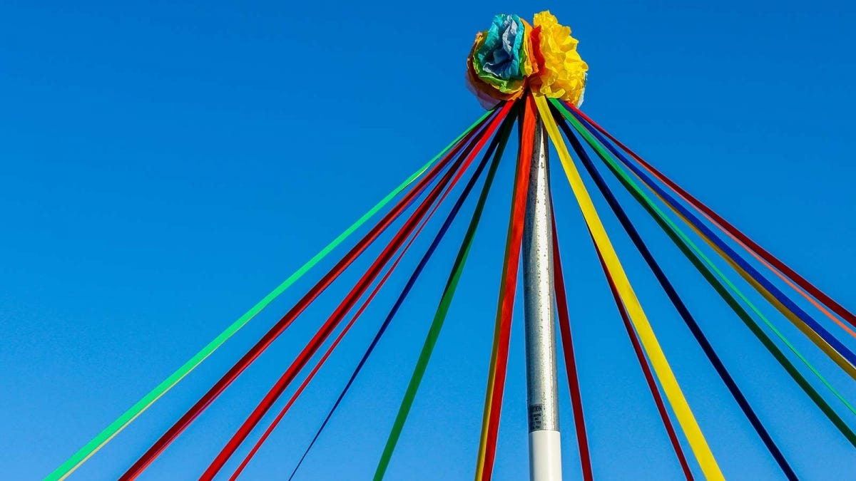 A May Pole decorated for a May Day celebration.