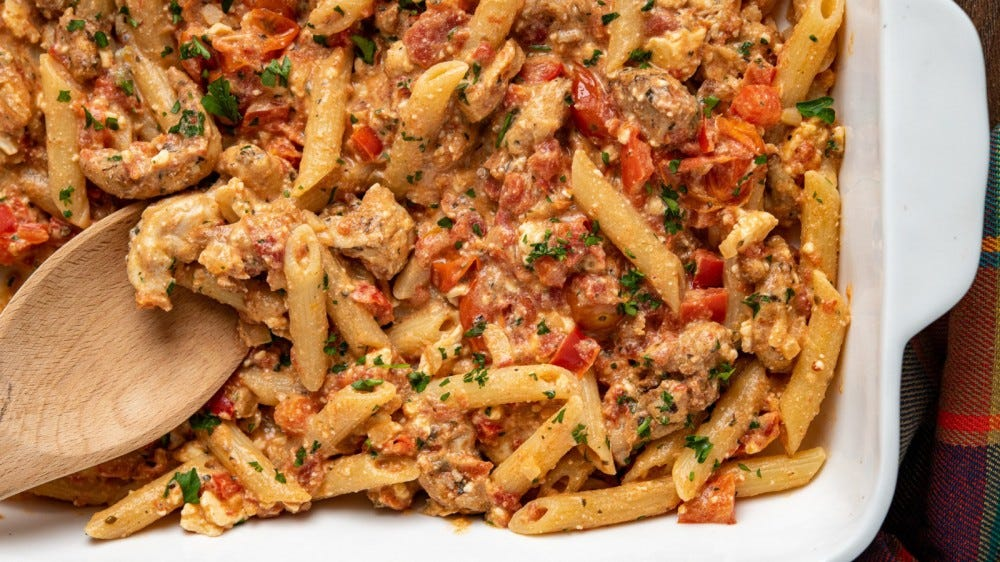 A platter full of baked feta pasta with chicken.