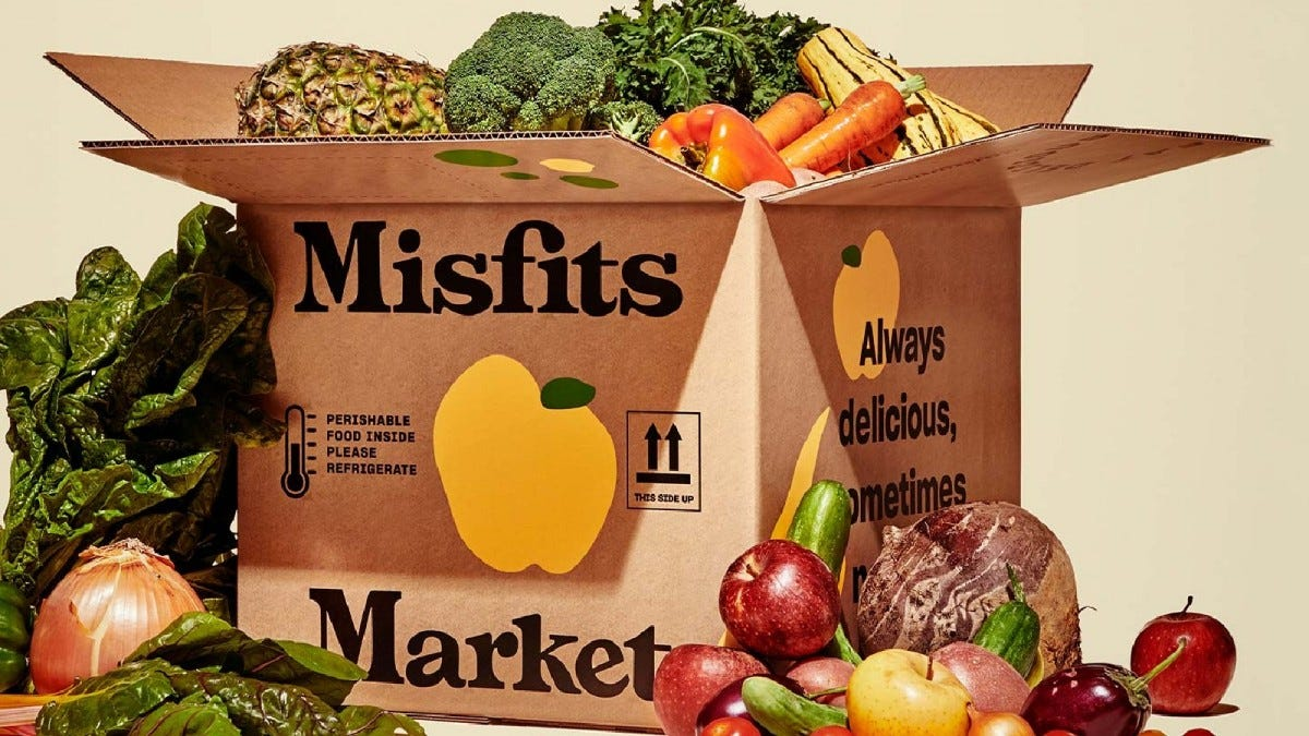 Misfits Market box overflowing with fruits and veggies.
