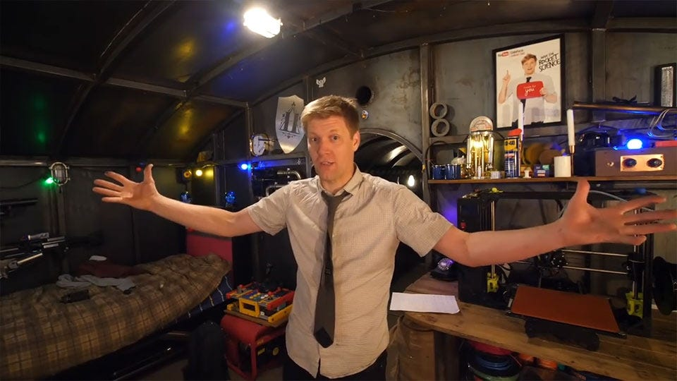 Colin Furze, standing in his underground bunker.