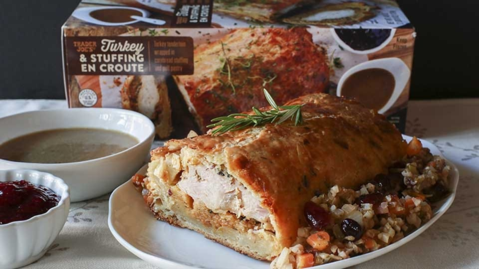 Trader Joe's 'Turkey & Stuffing en Croute' cooked and plated on a serving dish.