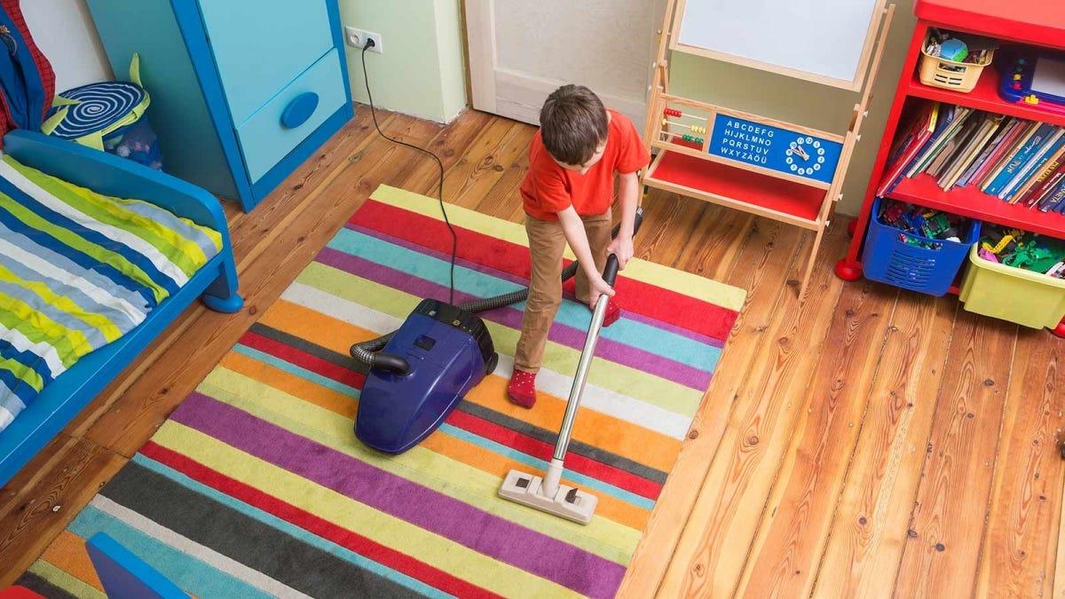 boy vacuuming his room