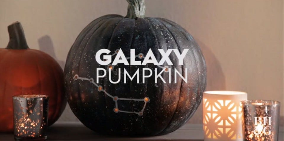 a pumpkin painted with constellations