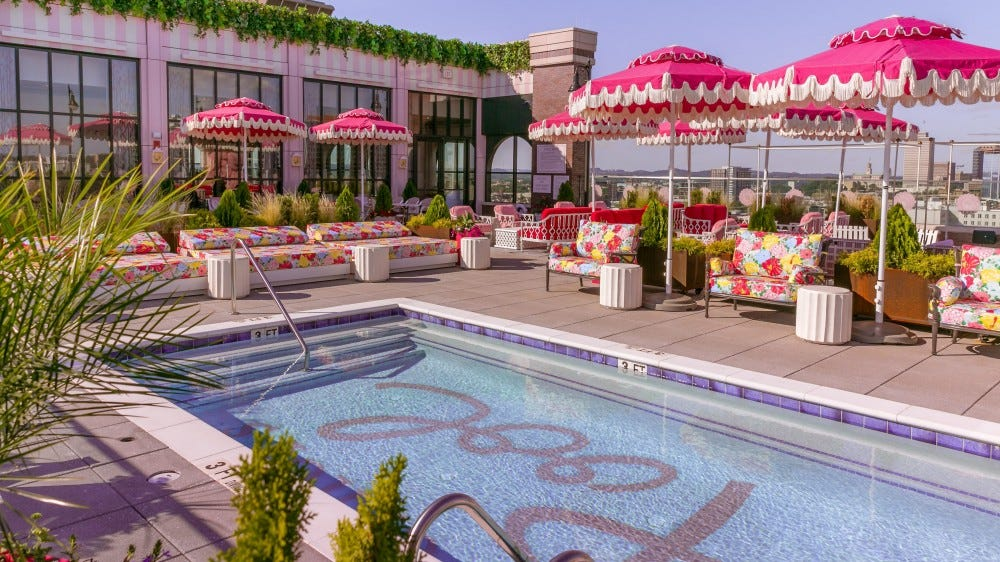 A Dolly Parton themed bar with pink umbrellas and a pool opened in Nashville.