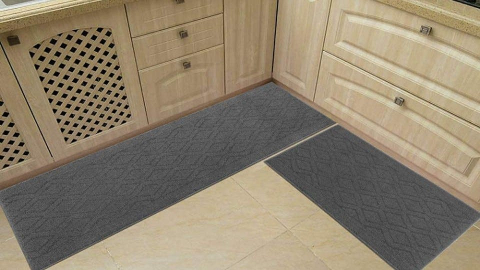 Two gray COSY HOMEER rugs in a kitchen.