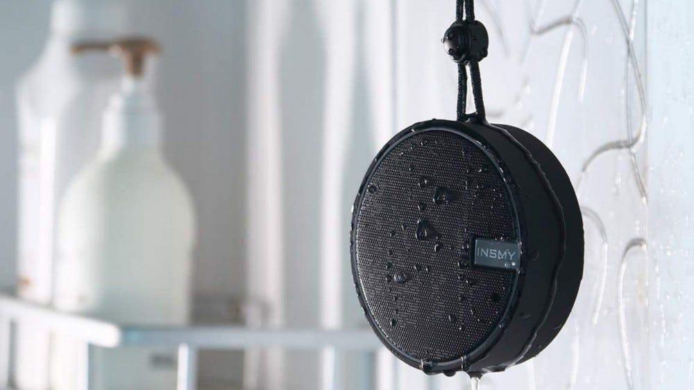 black speaker hanging in shower