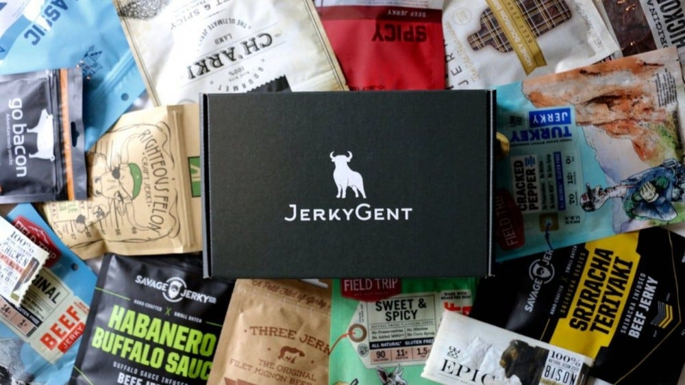 A JerkyGent box on top of a pile of different beef jerky packages.