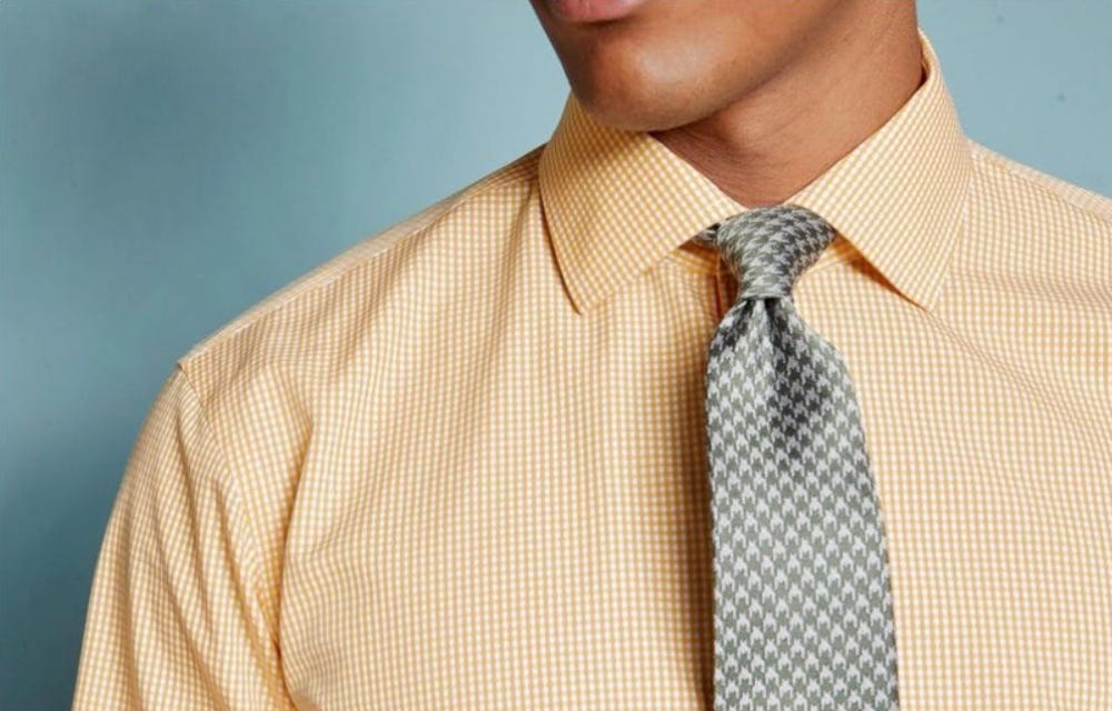 A man wearing a gray and white tie from Tie Bar.