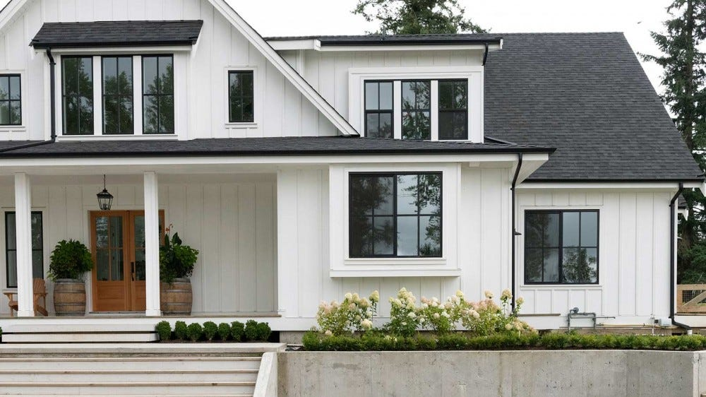 A modern home styled like a farmhouse.