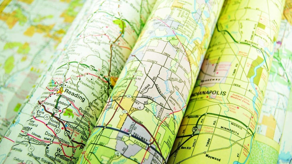 Old road maps folded up.