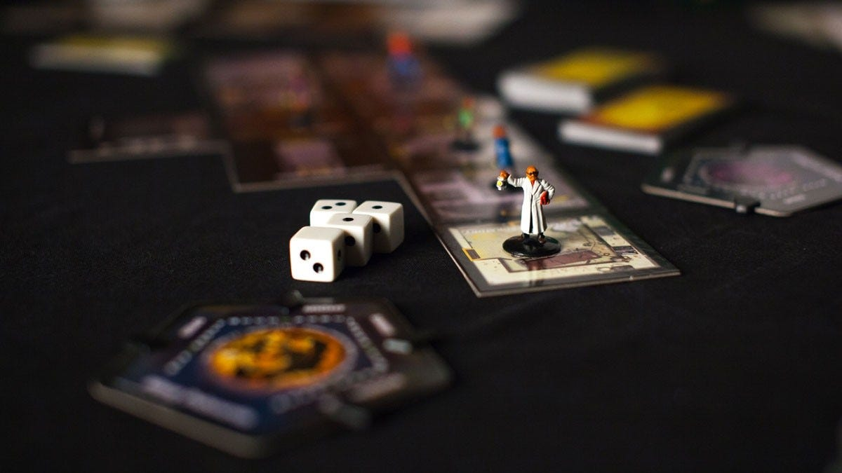 close up shot of the Betrayal at House on the Hill board with dice and figures