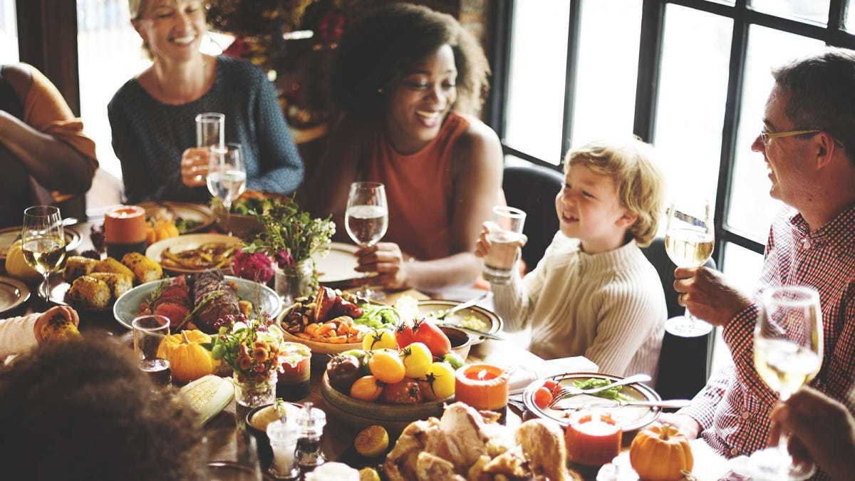 a holiday table with the children seated alongside the adults