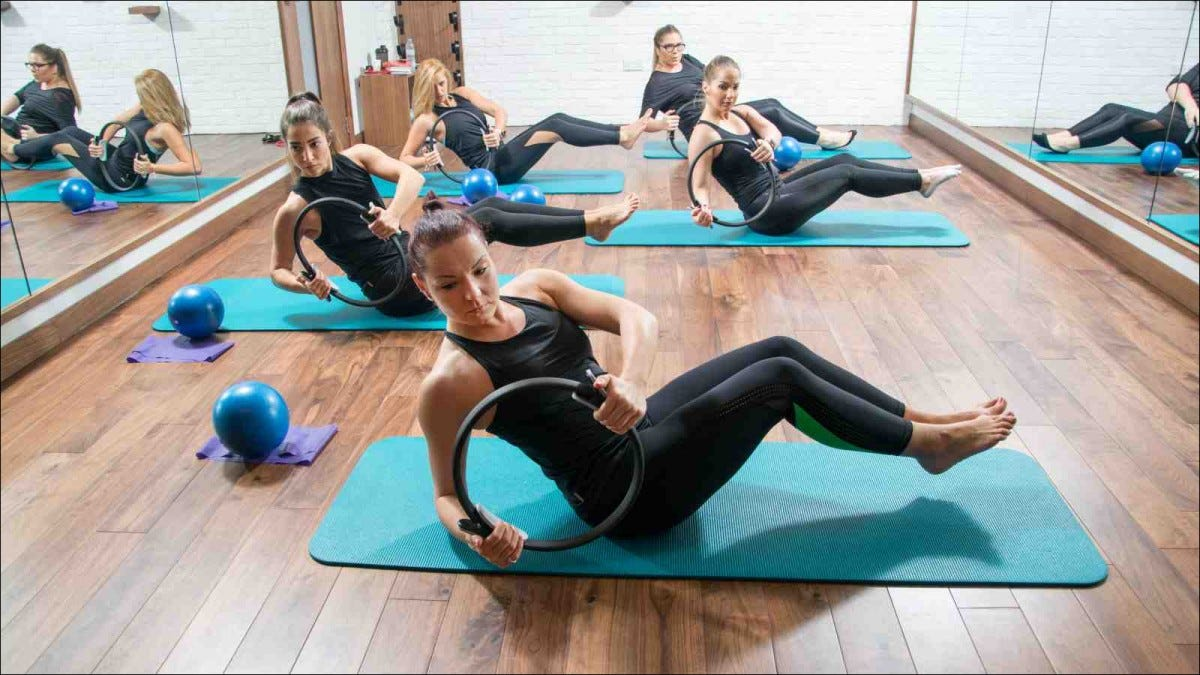 women doing pilates in studio