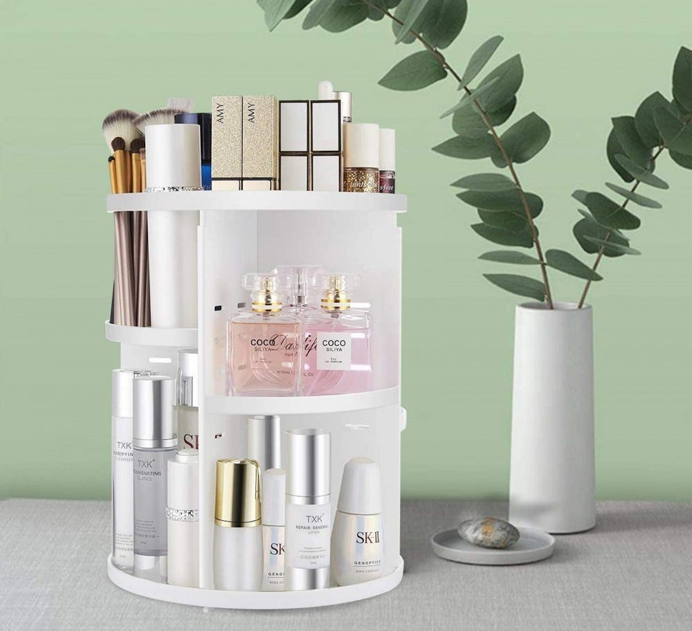 White rotating multitier caddy with makeup and cosmetics in it