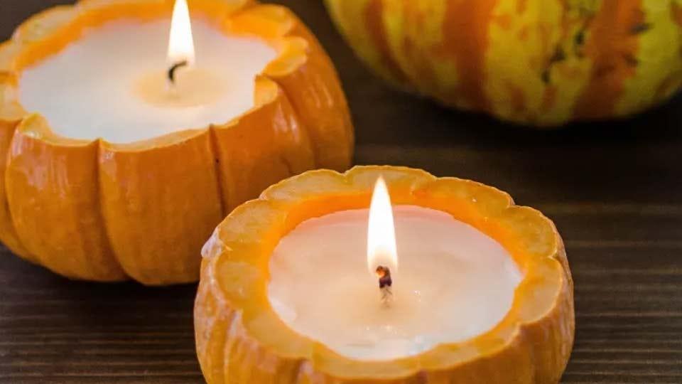 Two homemade pumpkin candles.