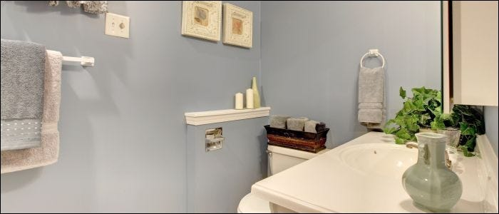 Simple yet cozy small bathroom with light blue walls