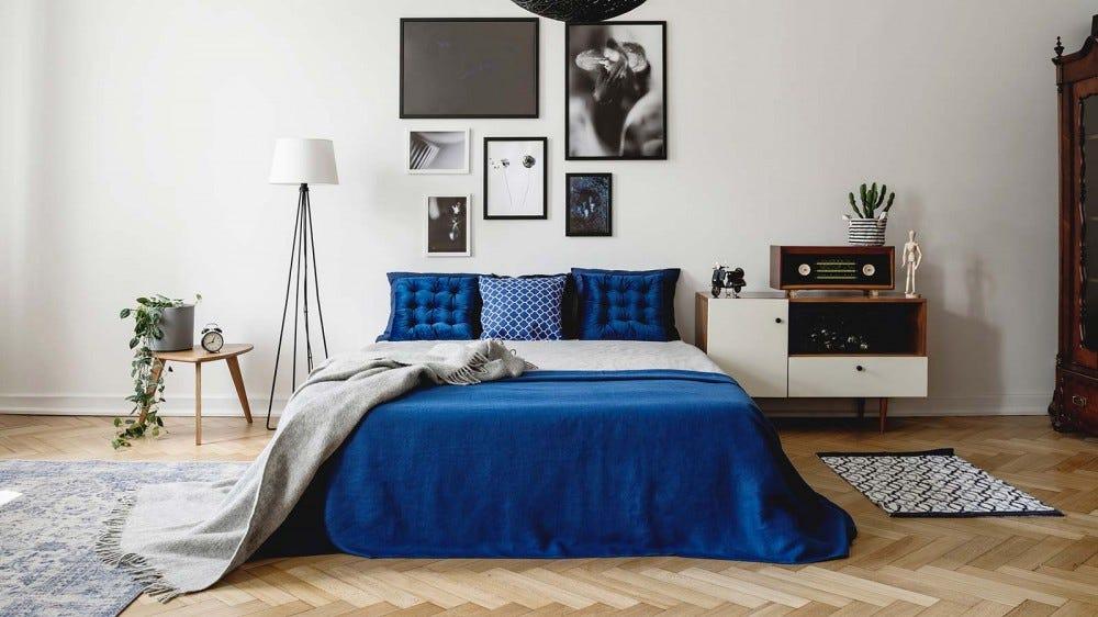 A minimalist bedroom with underbed storage.