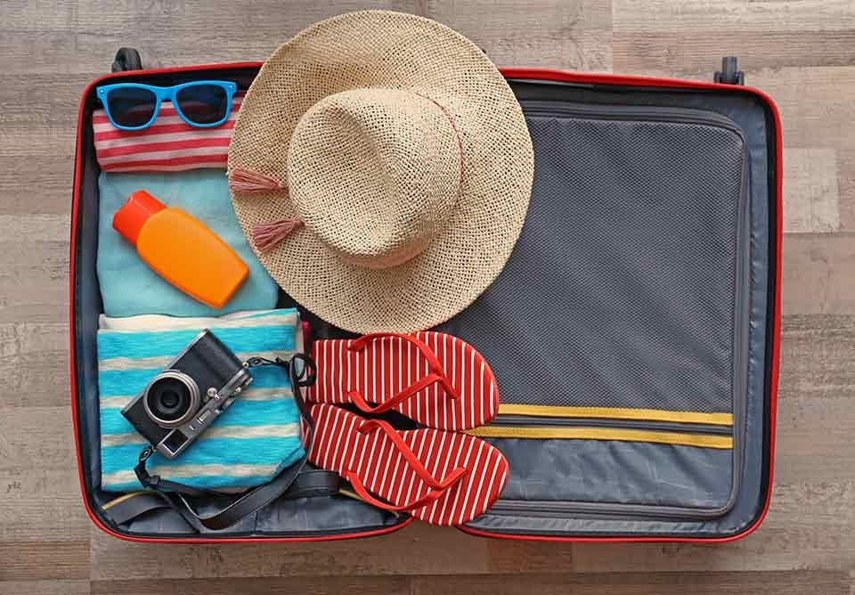 a suitcase packed with travel essentials