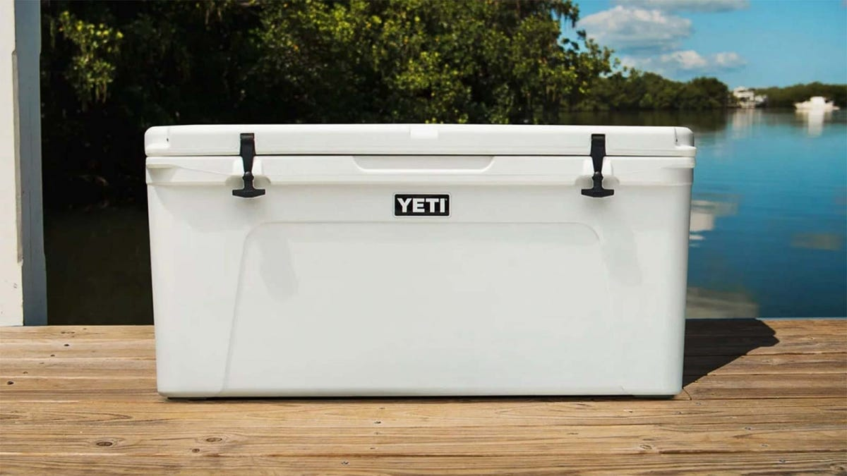 a large white Yeti brand cooler sitting on a dock