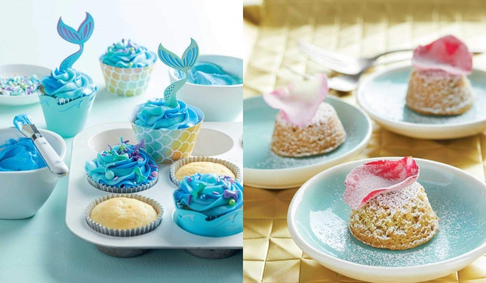 Groups of cupcakes with fishtails and plates of cookies are positioned next to one another.