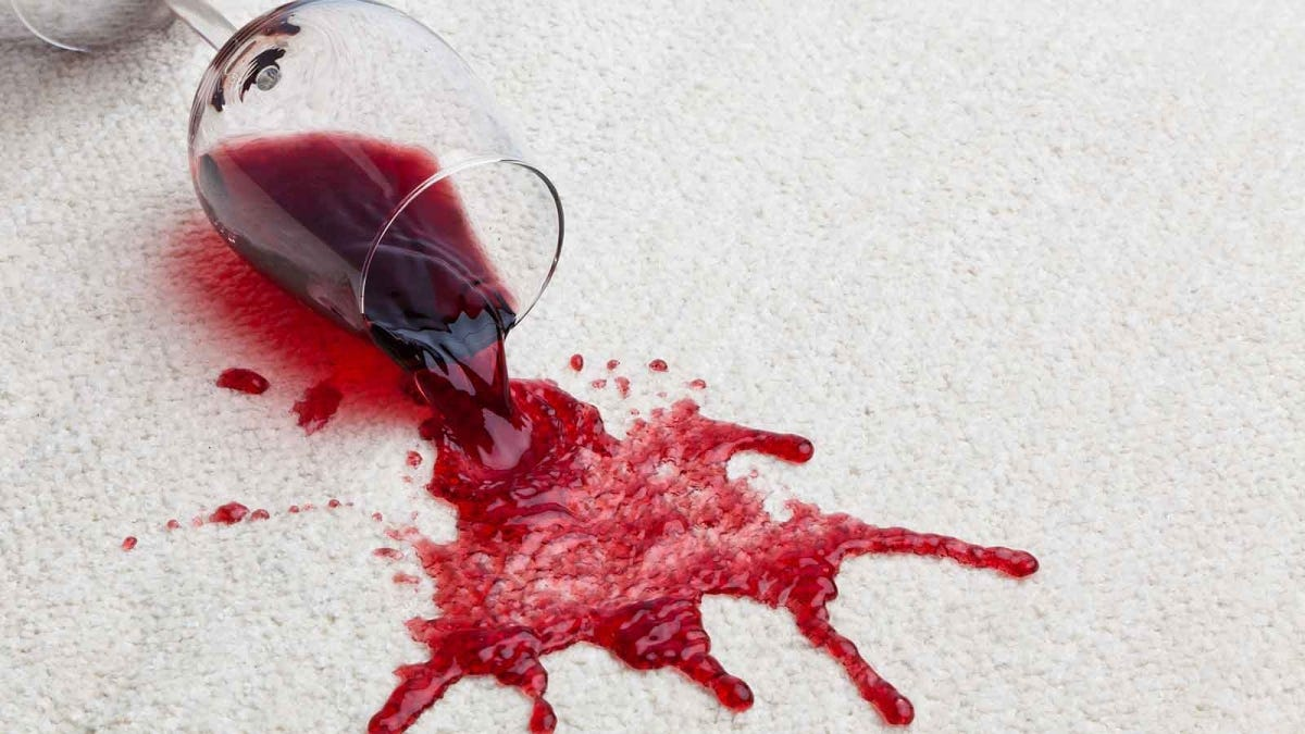 red wine spilling on a Berber carpet