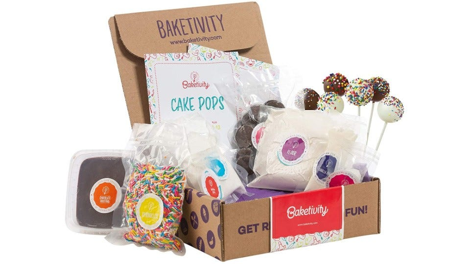 A baketivity kit with instruction booklets and pre-made ingredients.