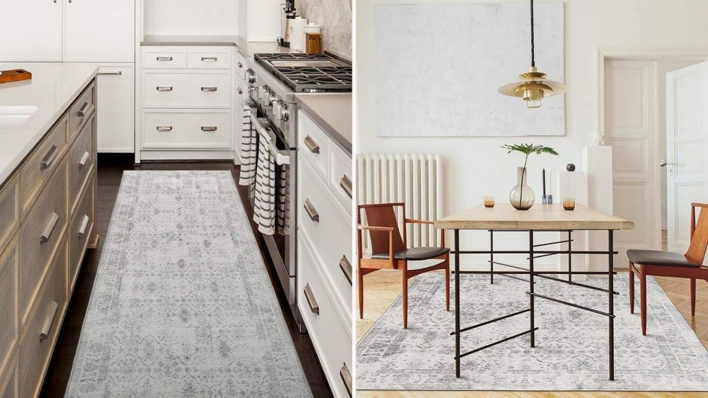 A rug between an island and a kitchen worktop, and a large weathered rug under a dining table.