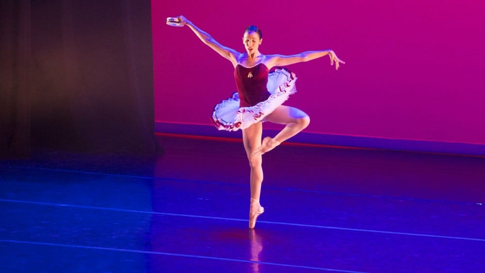 A ballet dancer performing onstage.