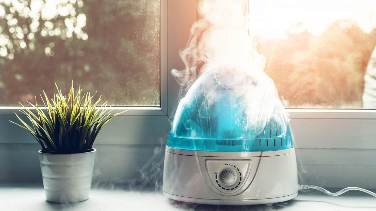 A small humidifier running in a sunny home to help raise the humidity and comfort level.