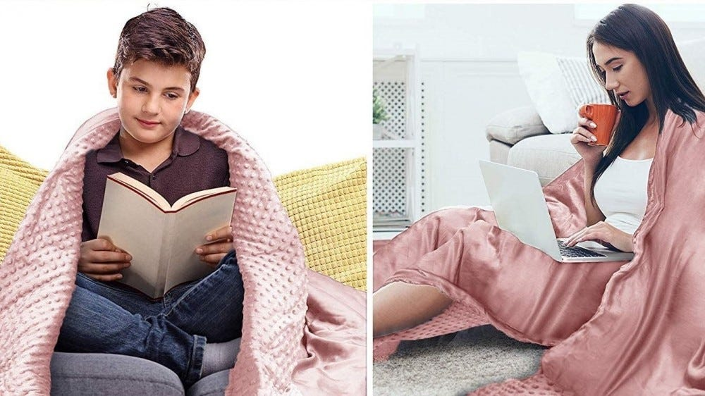 A boy and girl reading while covered up with different sides of the Alansma Reversible Weighted Blanket in pink.
