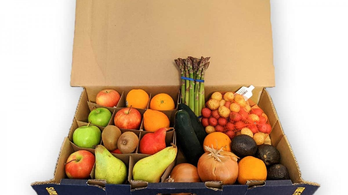 An open box full of fruit from The Fruit Guys.