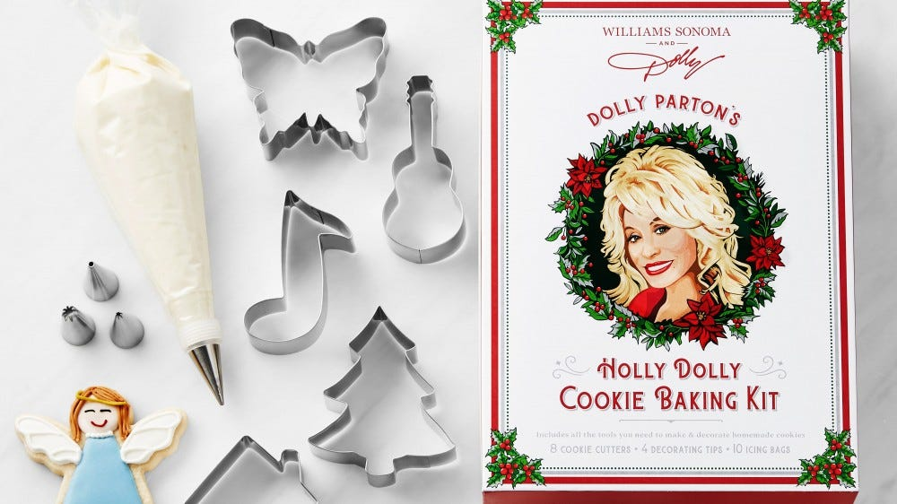 The 'Holly Dolly' cookie baking kit from William Sonoma, featuring music and Christmas themed cookie cutters.