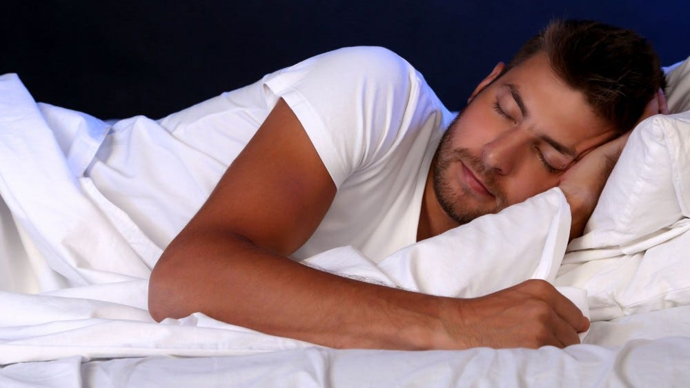A man sleeping in bed.
