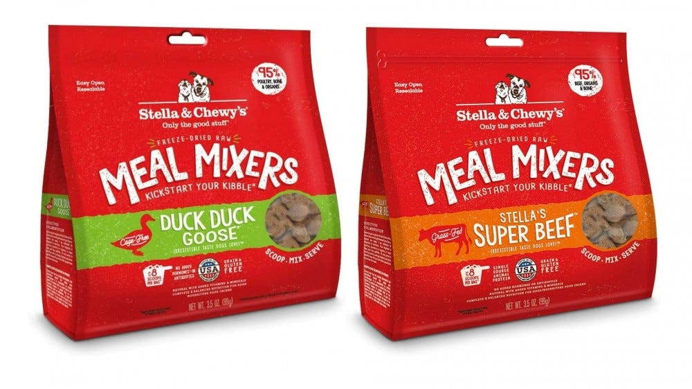 two red bags of dog food toppers