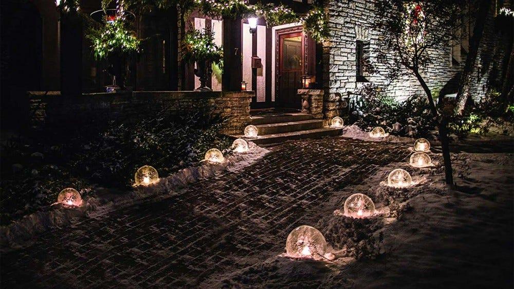 A walkway decorated with ice globe luminaries.