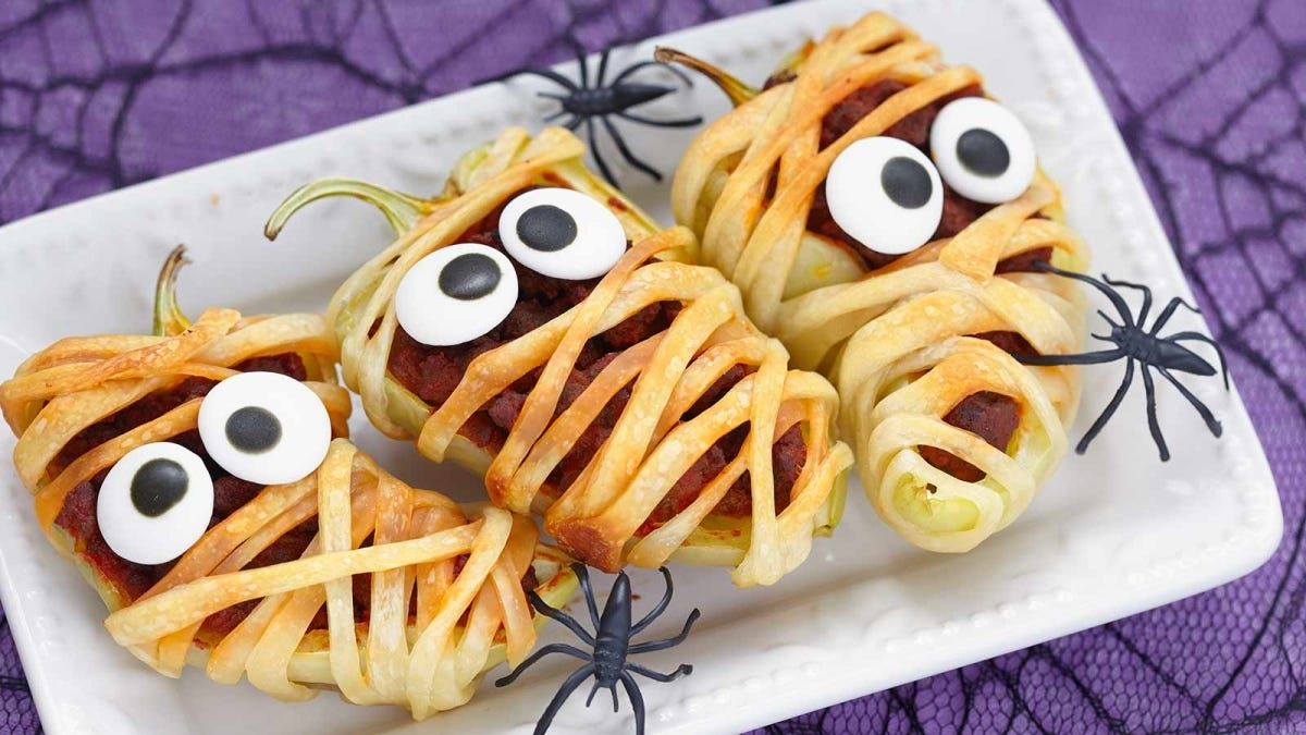 stuffed peppers wrapped in pastry to look like mummies for Halloween