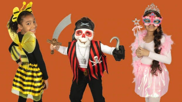Two girls and a boy wearing Halloween costumes from Dollar Tree.
