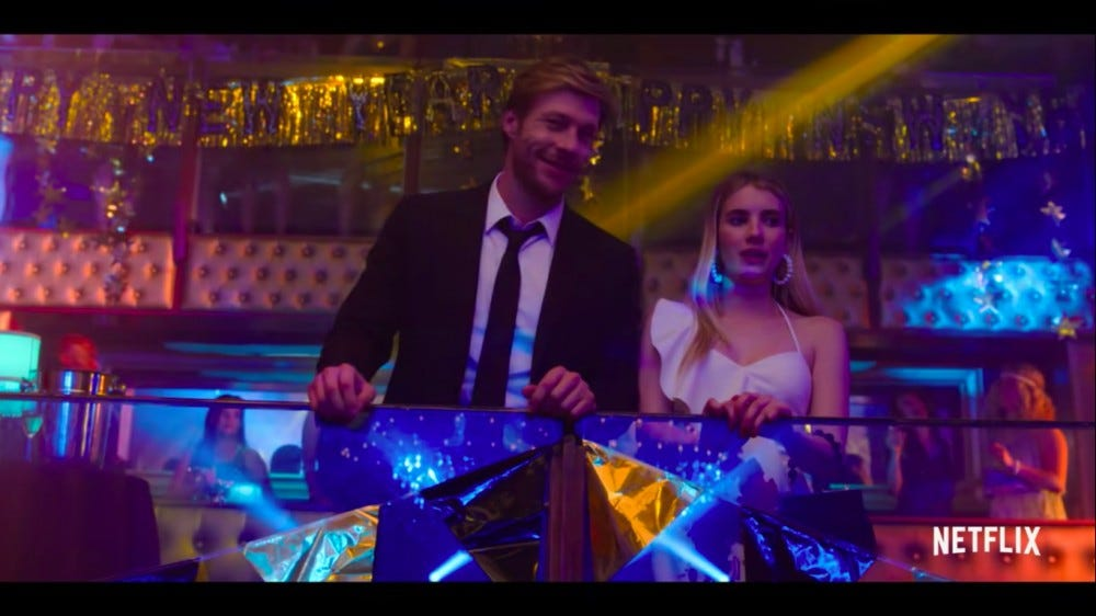 "Luke Bracey and Emma Roberts in a scene from ""Holidate."""