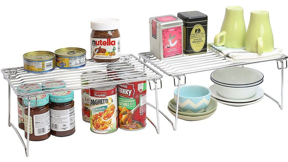 Jars, cans, teacups, and bowls sitting on two Deco Brothers Organizer Racks.