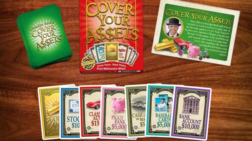 A hand for the Cover Your Assets card game.