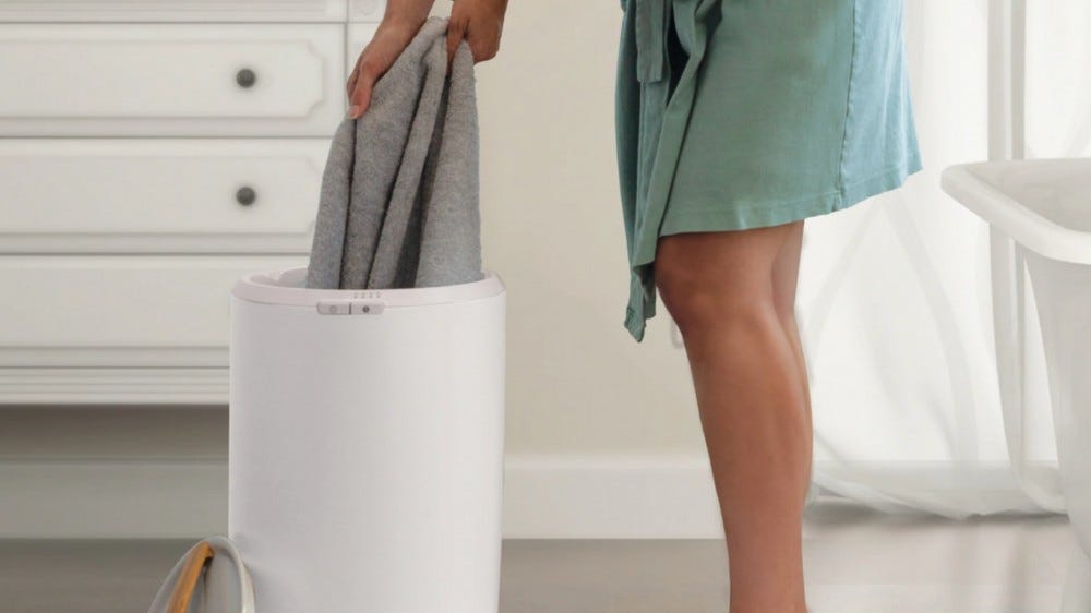 person pulling towel out of the towel warmer