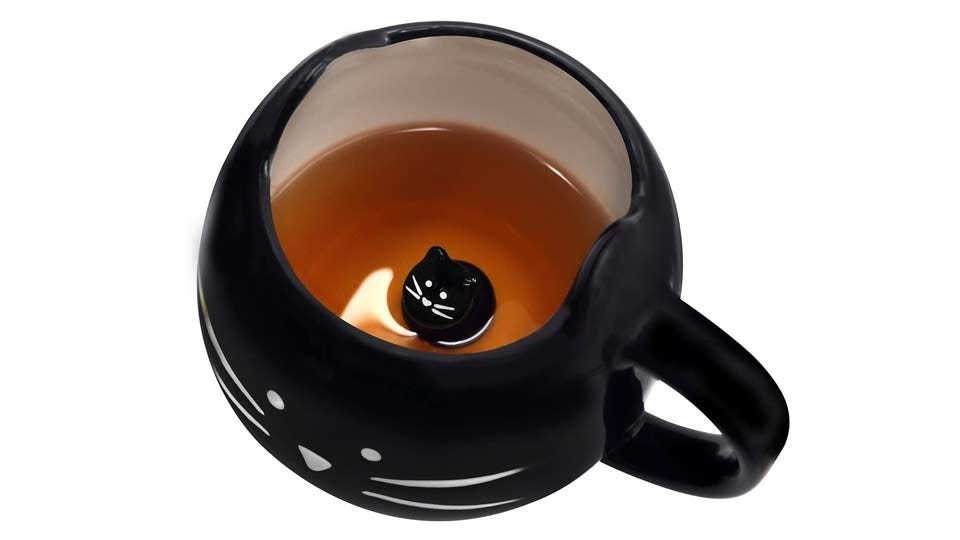 Black mug with a cat face on the front, and a black cat inside.