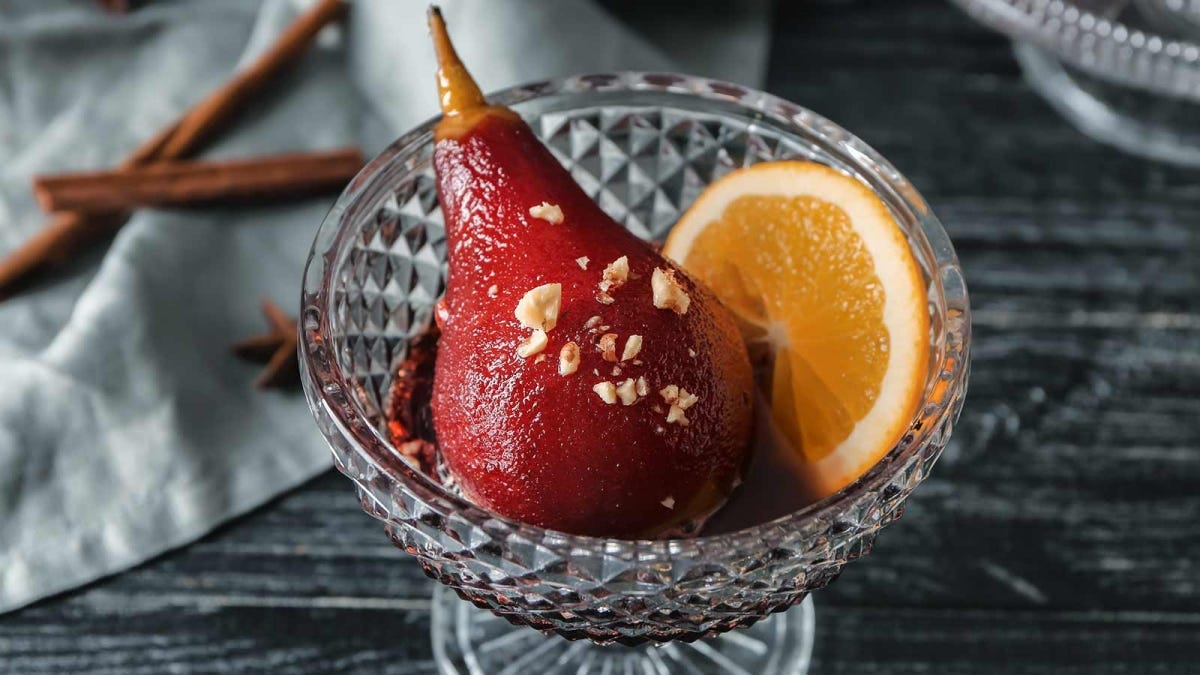 a pear poached in red wine resulting in a very dramatic and rich red color change