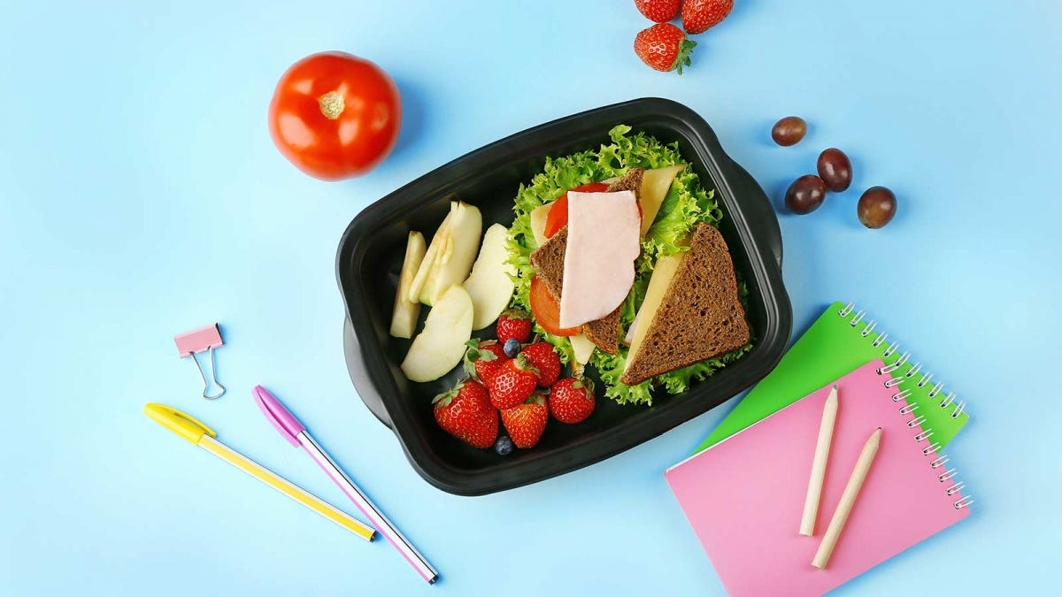 A large plastic deli container reused as a lunchbox.