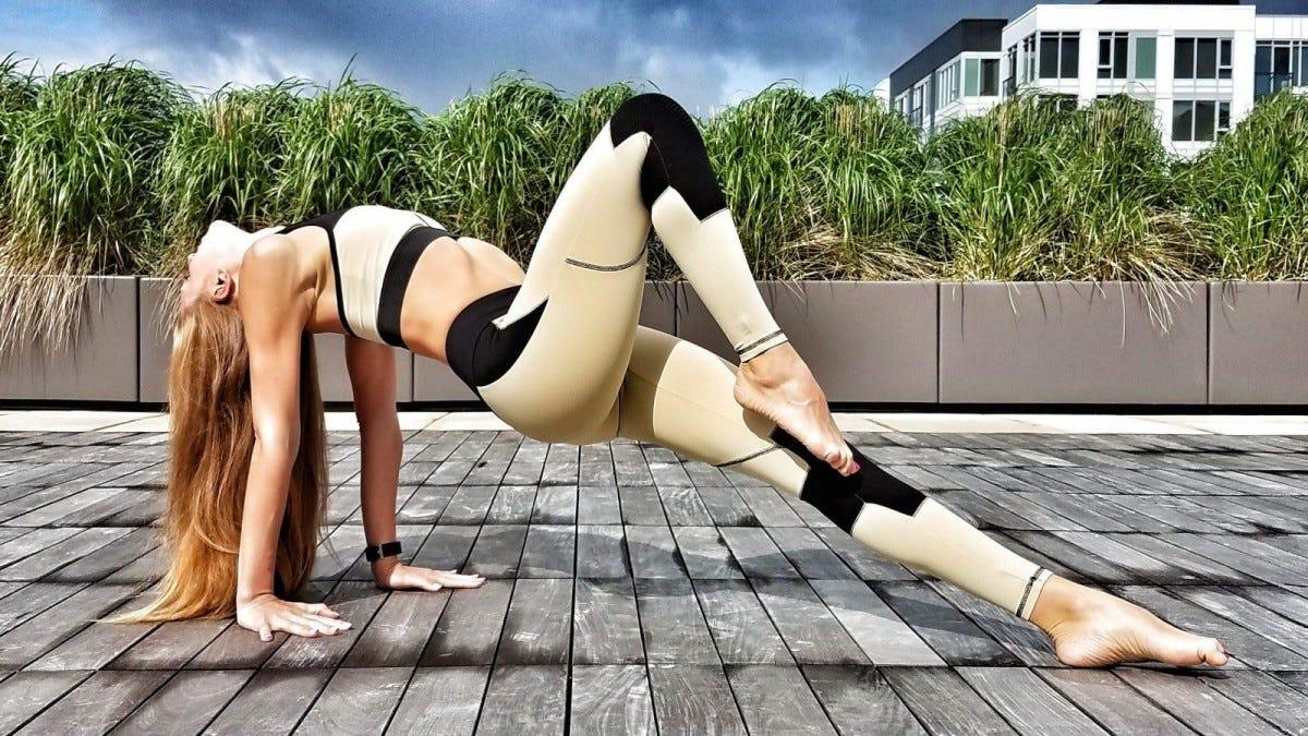 Woman doing an upward plank in yoga