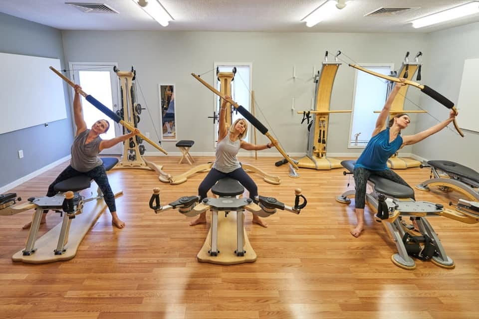 Three women in a Gyrotonic class.