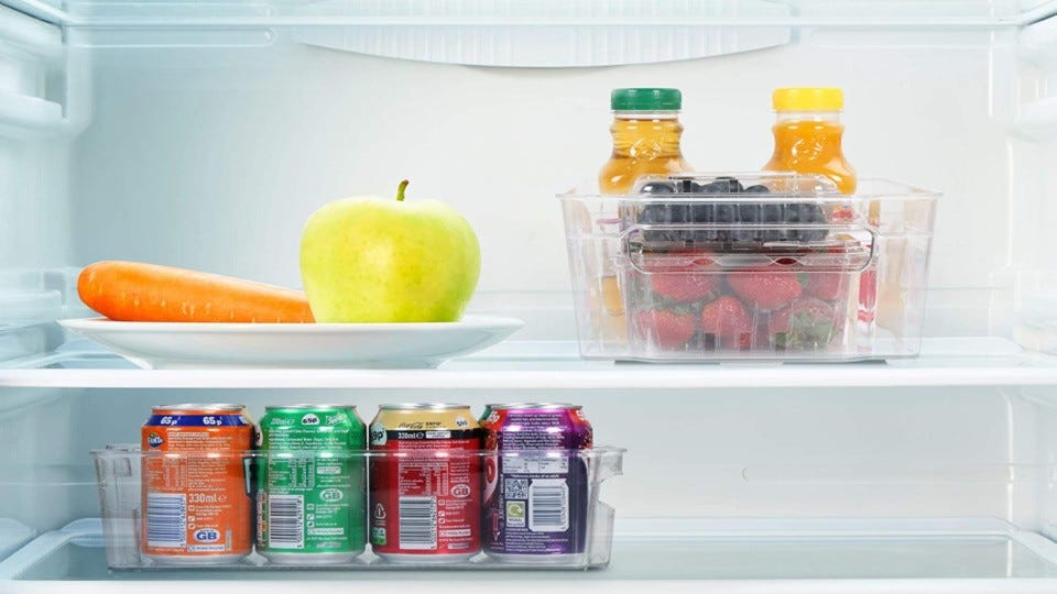 Two Utopia plastic organizers filled with various foods and drinks in a fridge.