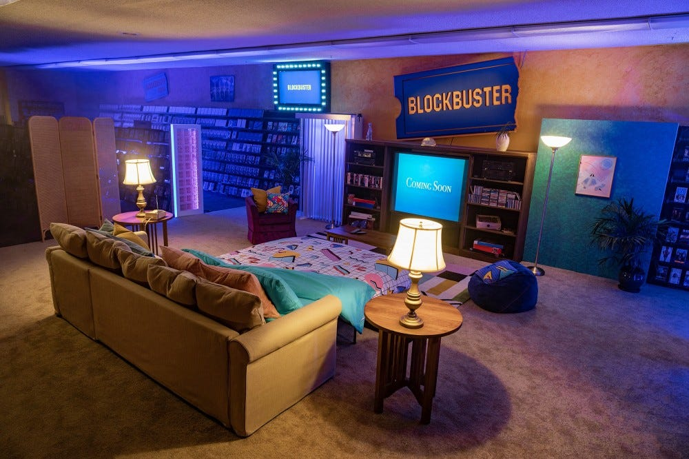 An old Blockbuster is revamped to include a pull out couch and and 90s decor.