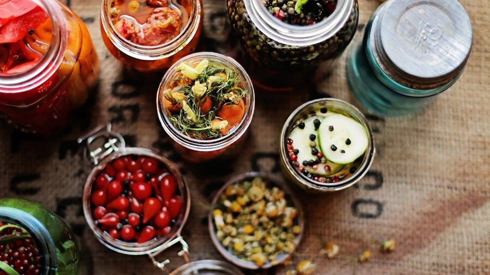 Jars of various pickled foods.